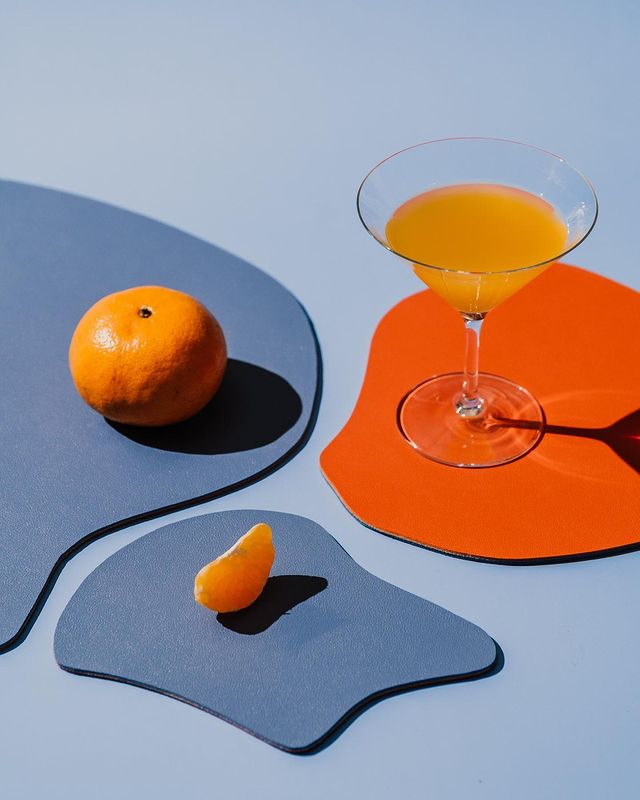 multi-purpose catch all mats from GVN the label in tangerine and cornflower