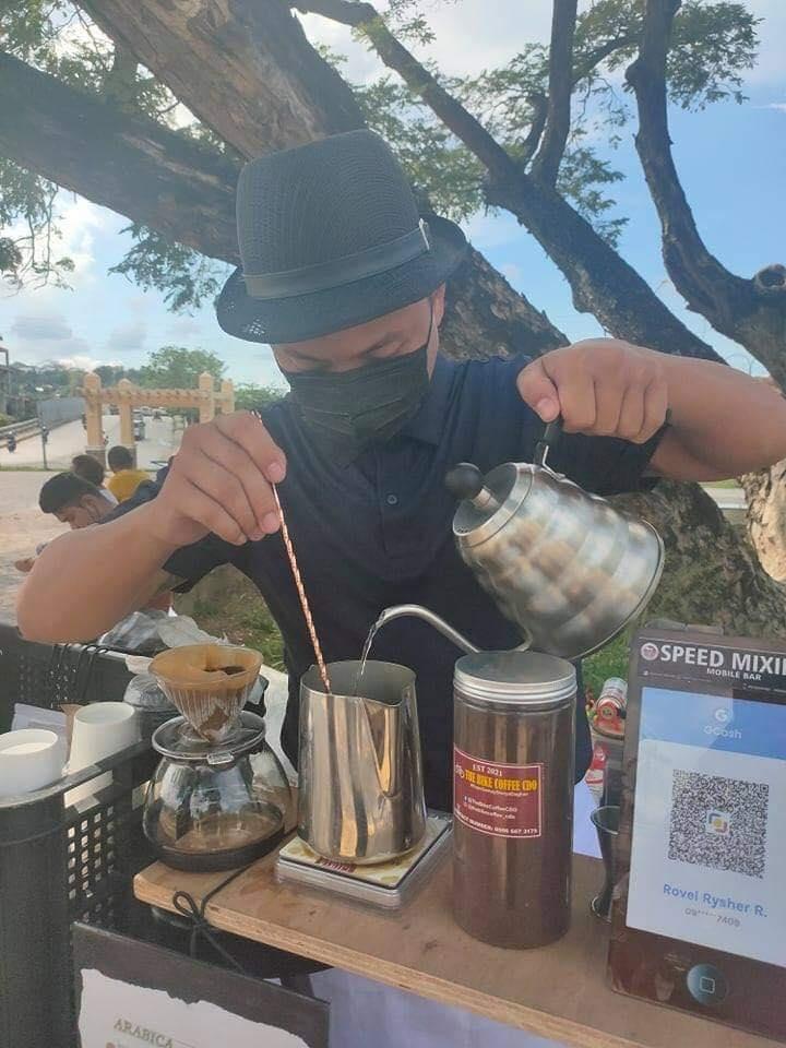 Cocoy of The Bike Coffee CDO making coffee
