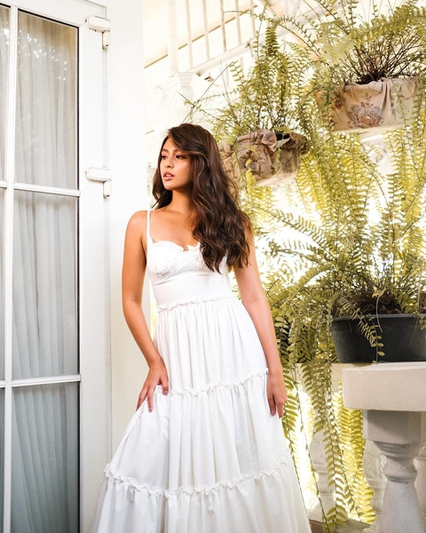 White maxi dress with ruffle detailing