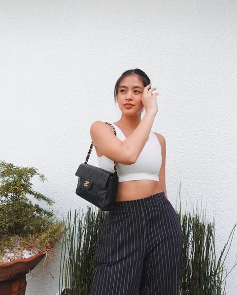 White bralette + black striped trousers + black handbag