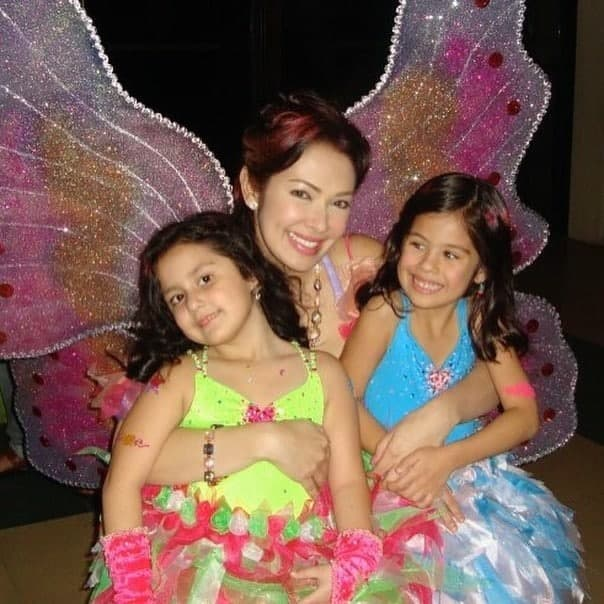 Ruffa wearing a fairy costume with her daughters