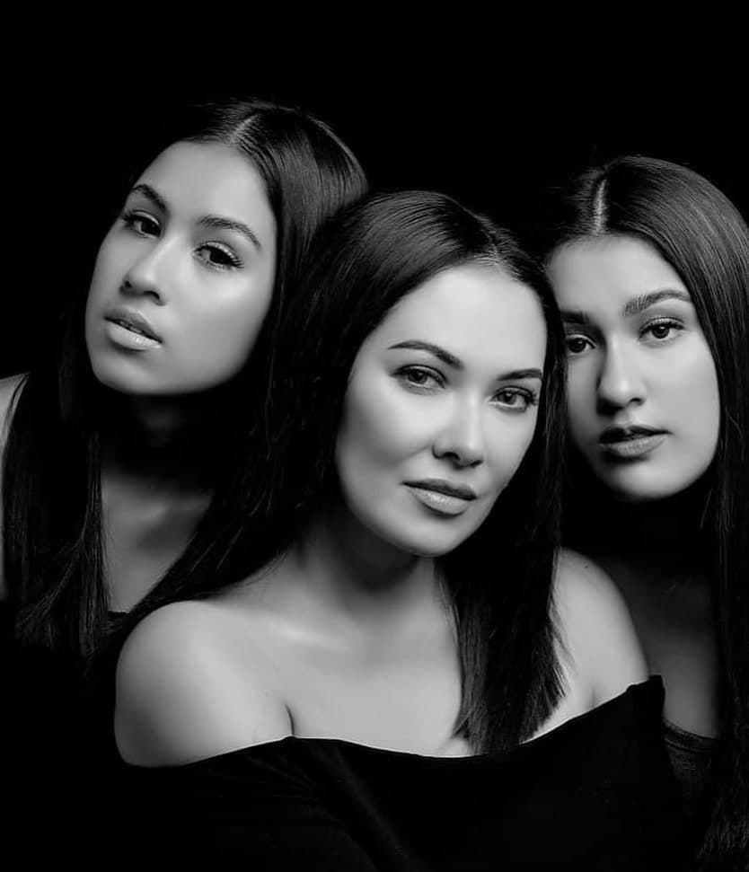 Ruffa and her daughters posing in a black and white photo