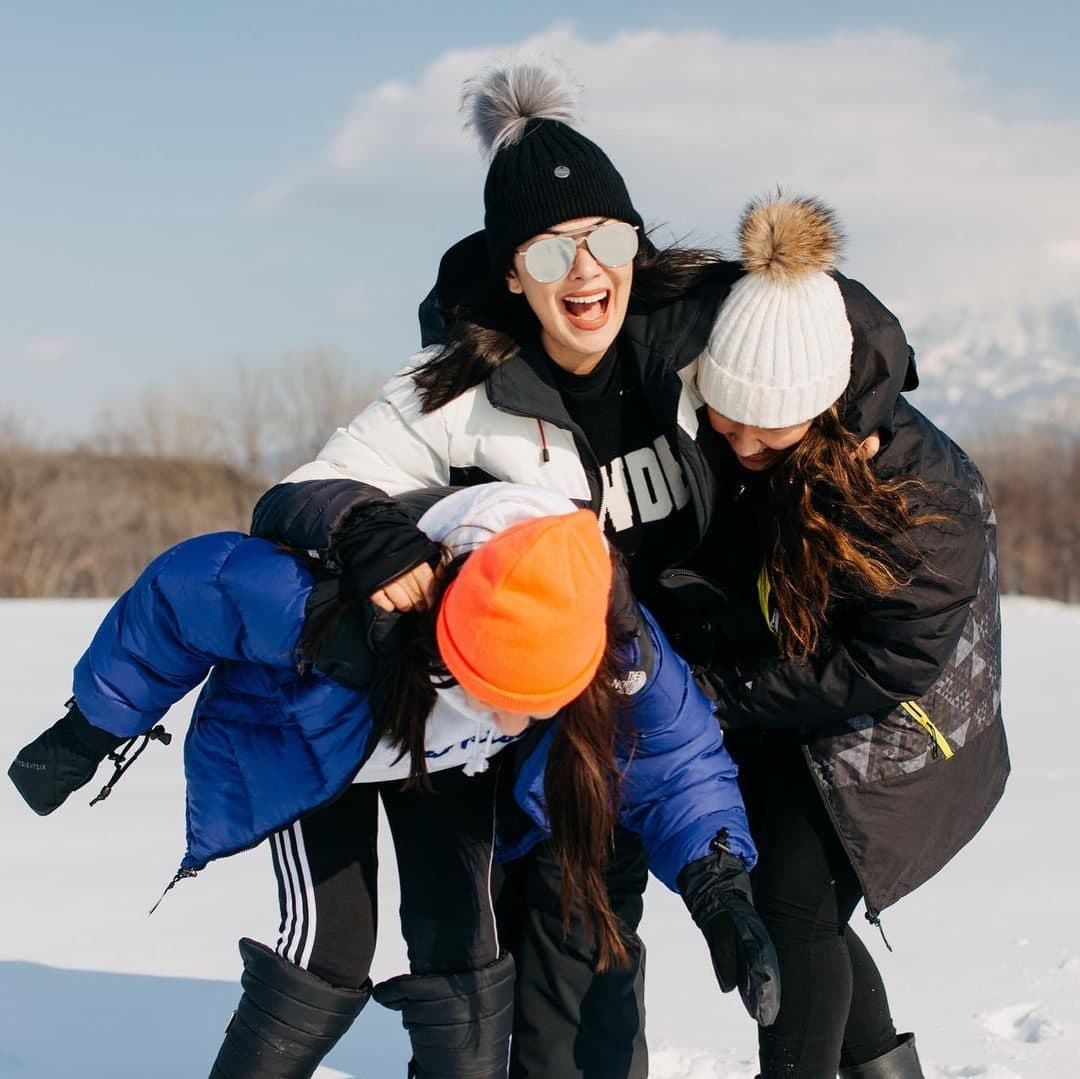 Ruffa with her daughters enjoying the snow