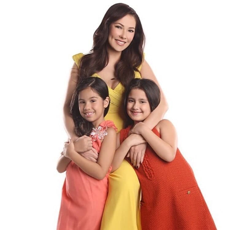 A picture taken in a studio of Ruffa and her daughters