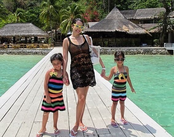 Ruffa and her daughters on a pier