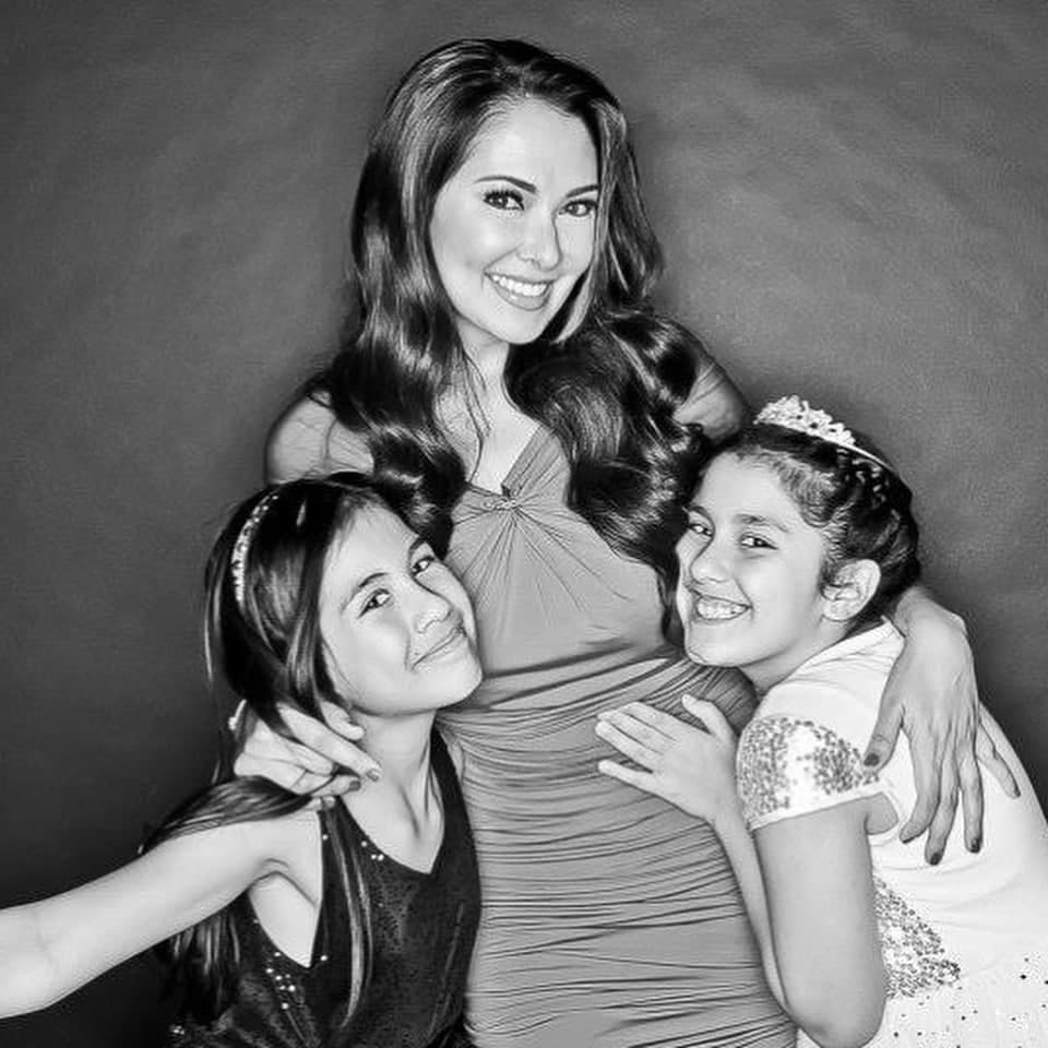 A black and white photo of Ruffa with her daughters