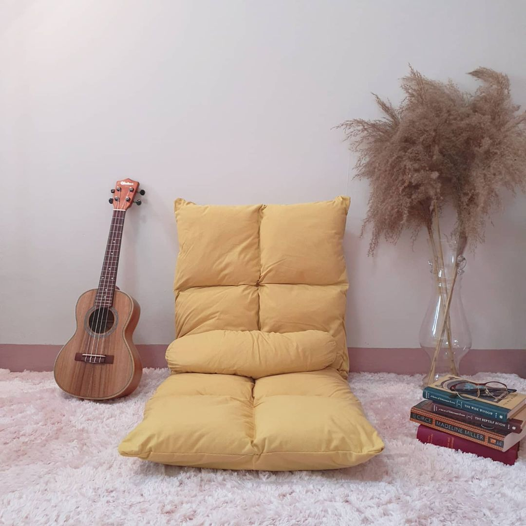 reclining chair from Tatamii Home in Sunset Yellow