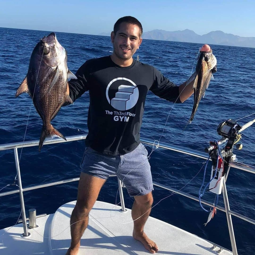 Gerald Anderson posing with caught fish