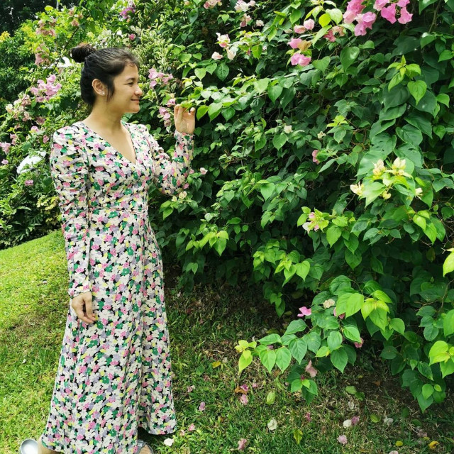 Camille Prats wearing a floral maxi dress