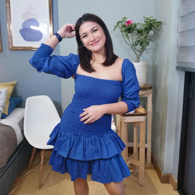 Camille Prats wearing a blue dress