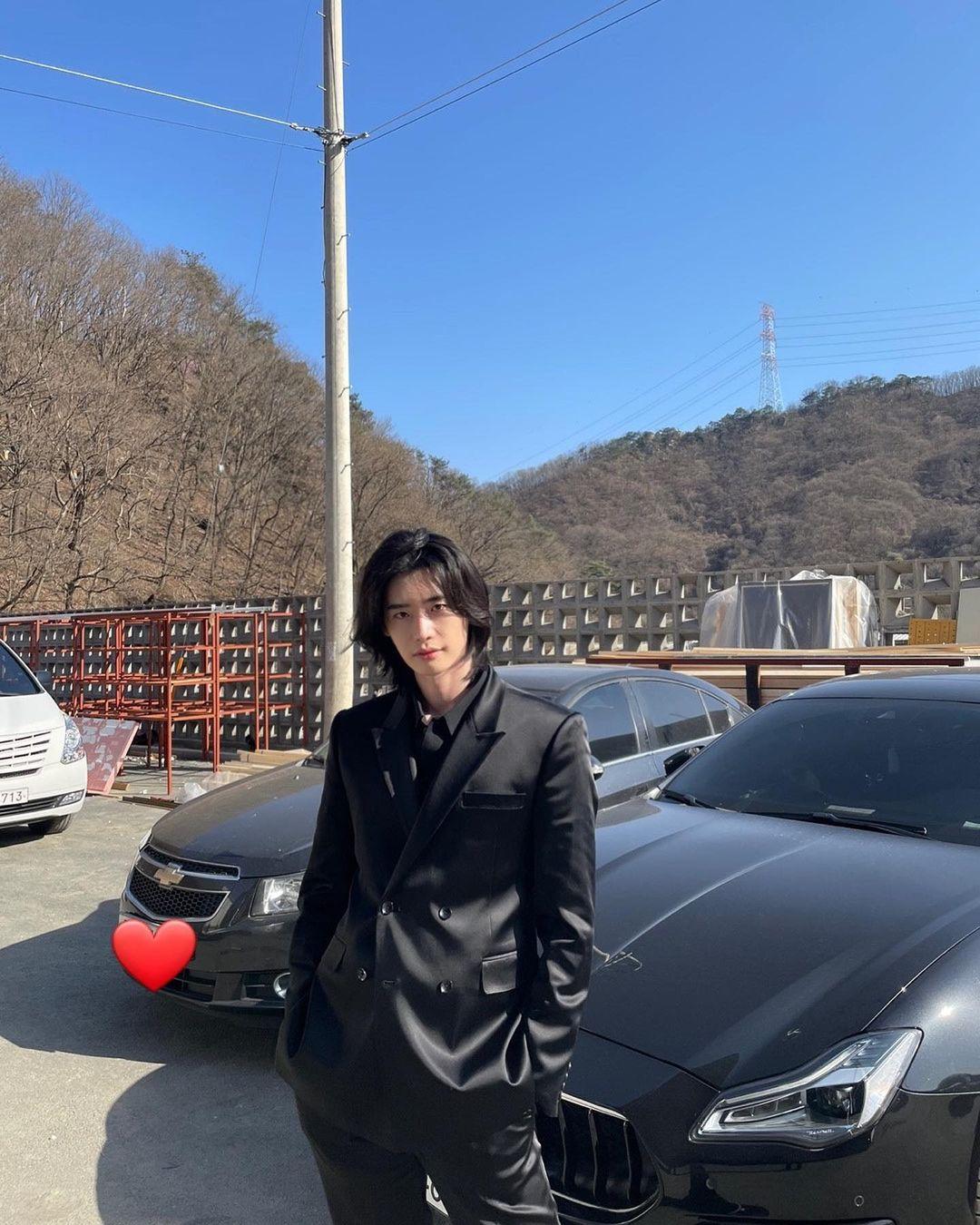 Lee Jong Suk wearing a black suit