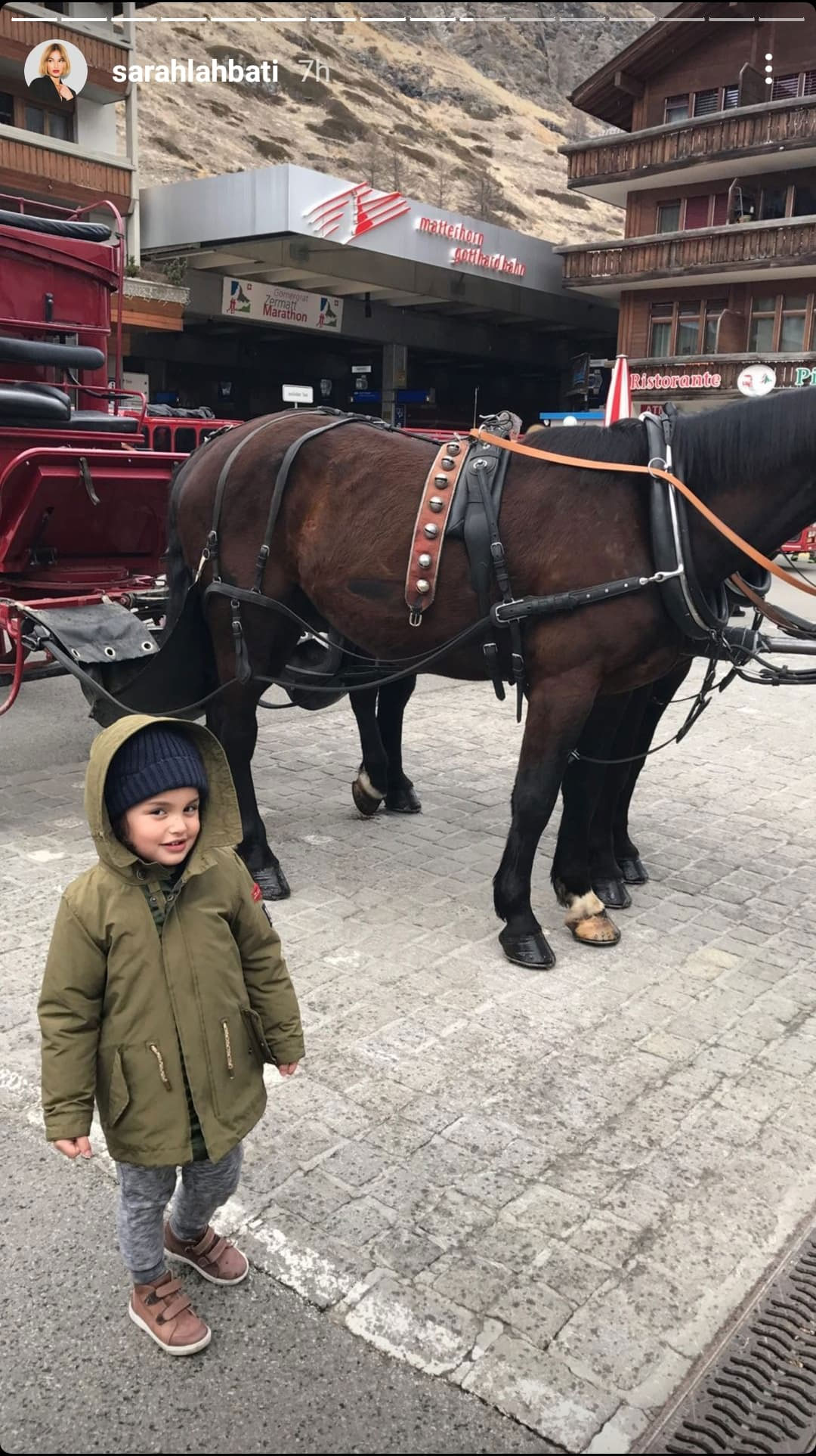 Zion posing with a horse