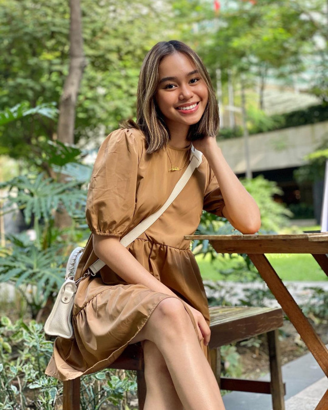 Bella Racelis wearing a neutral-colored outfit