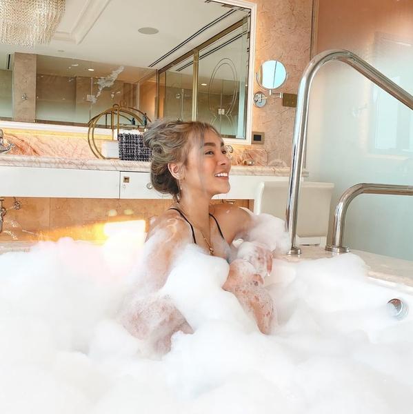 Christine Samson getting a bubbly bath