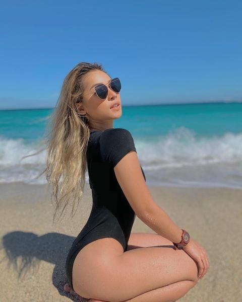 Christine Samson posing on the beach