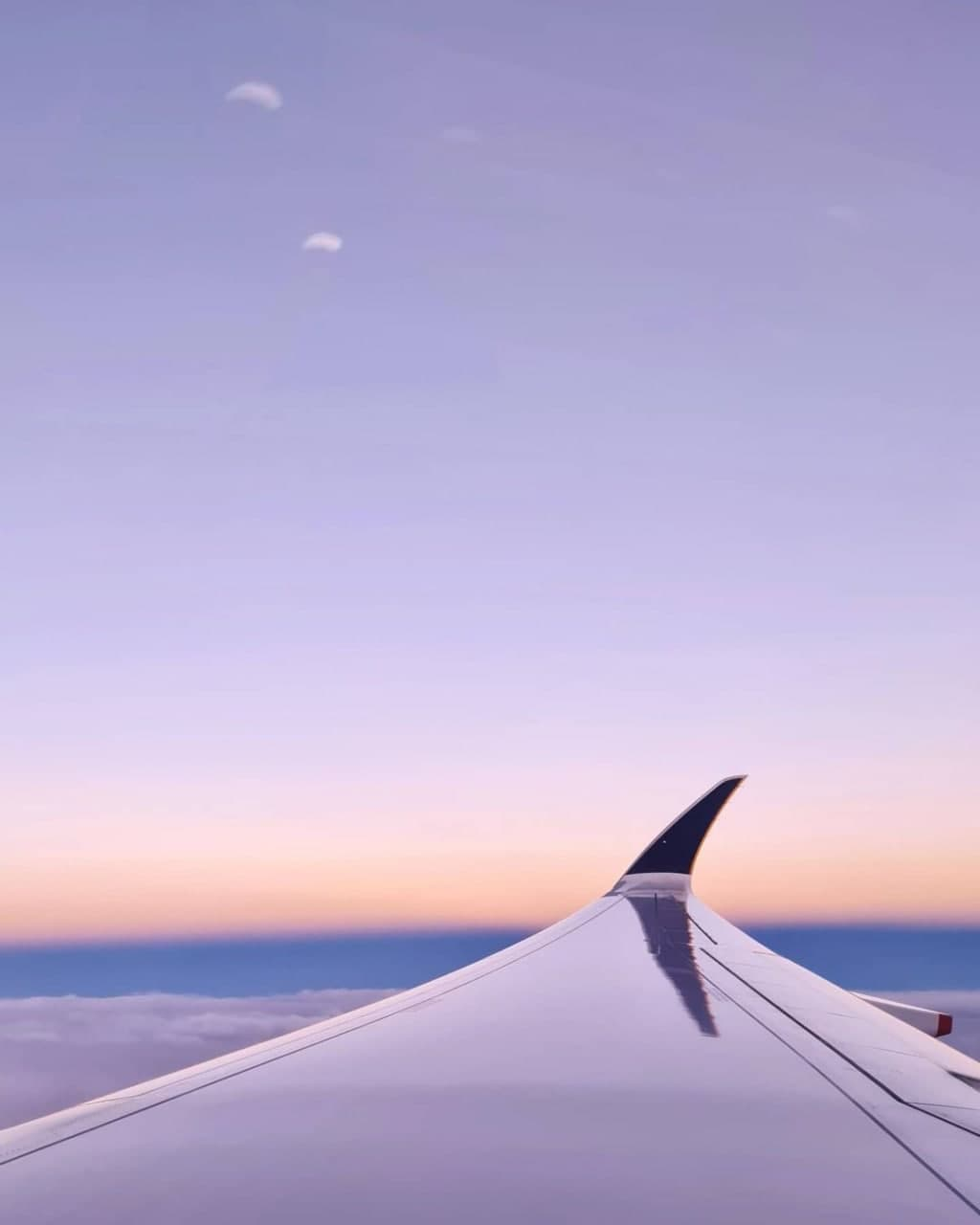 An airplane's wing as seen from the passenger's window