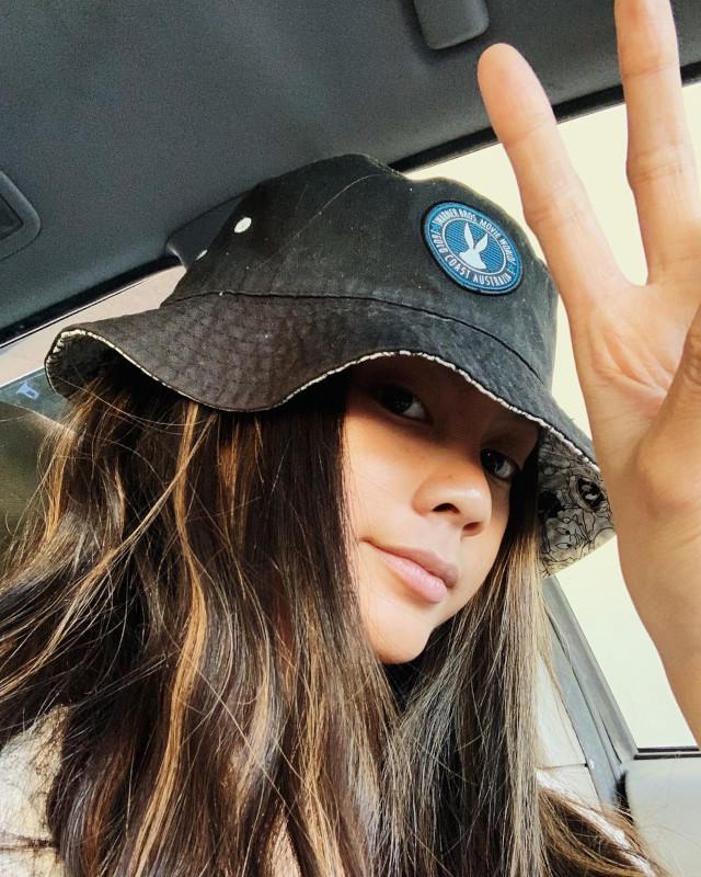 Ylona Garcia wearing a bucket hat