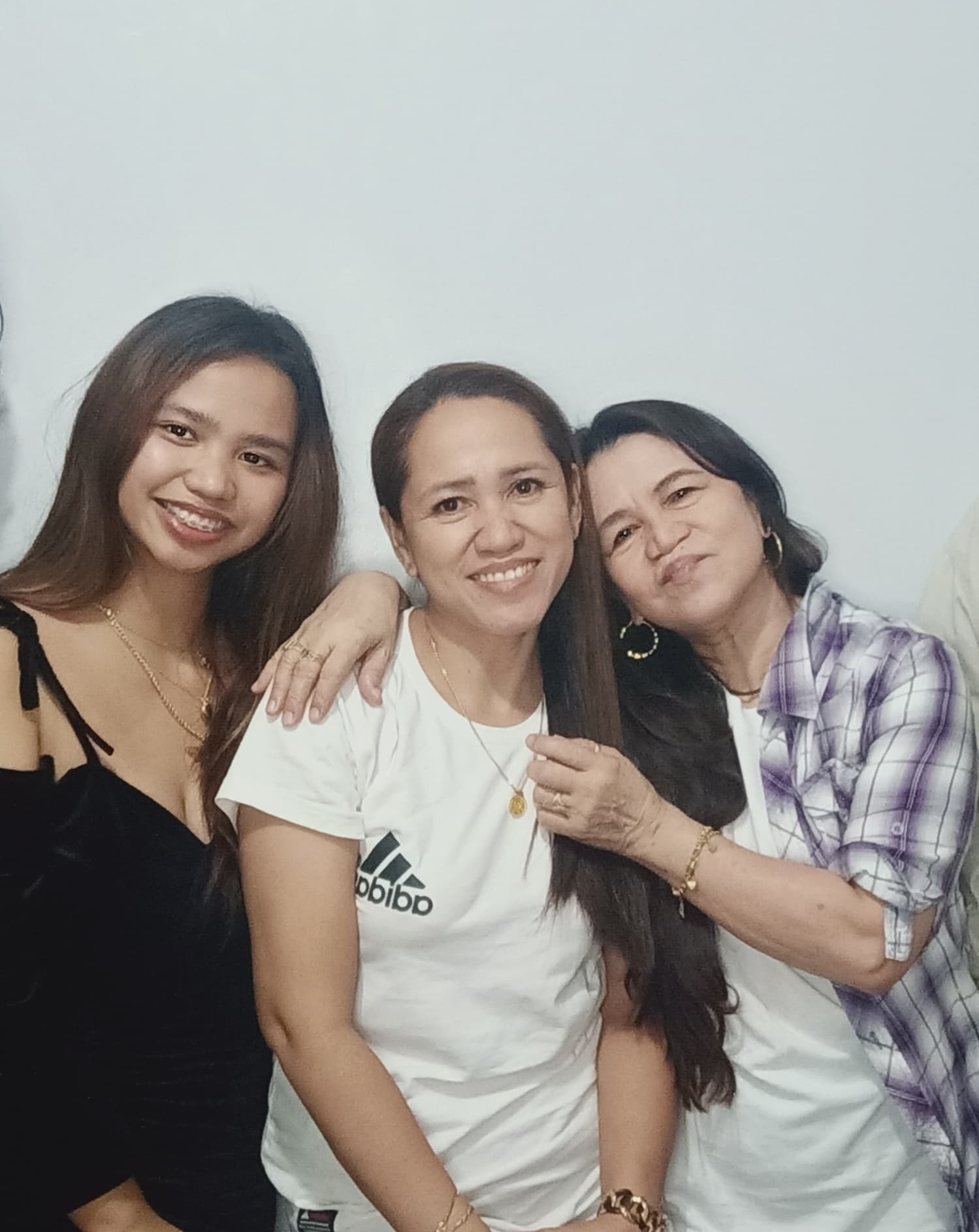 Family photo of a Pinay and her lola - Excelsia
