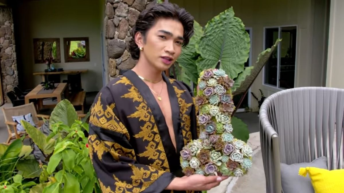 Bretman Rock holding favorite home decor from his front yard