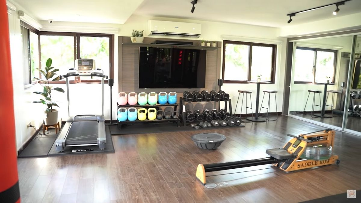 Bea Alonzo home gym: rowing machine and weights rack