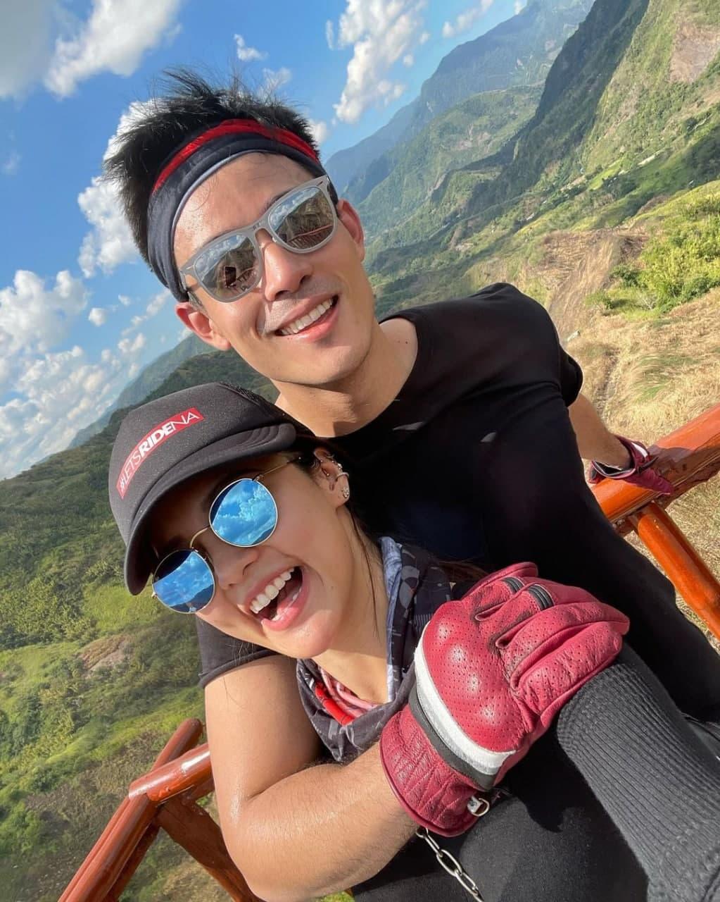 Xian Lim and Kim Chiu taking a selfie over a mountainous background
