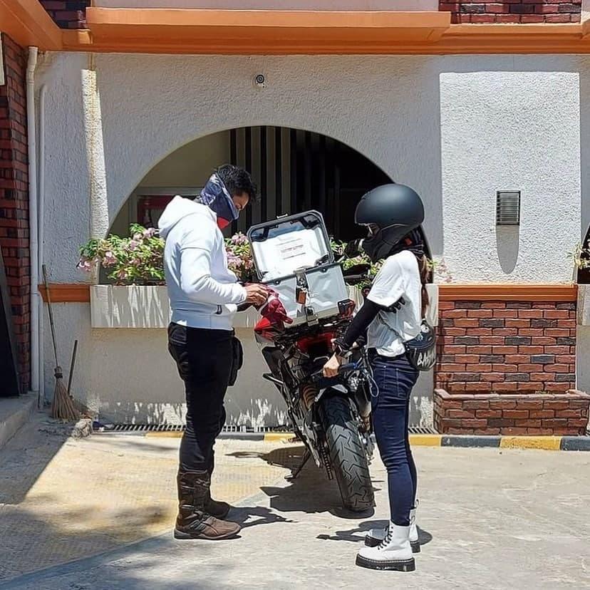 Xian Lim and Kim Chiu preparing to ride a motorcycle