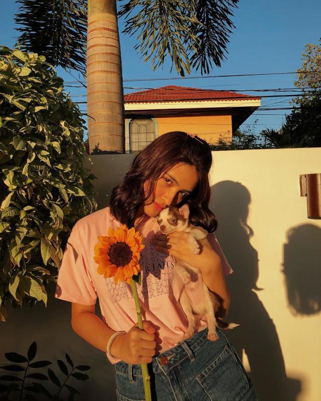 Sam Cruz's golden hour selfie: posing with dog