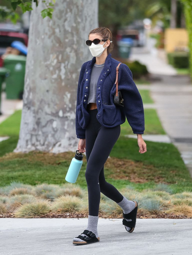 Kaia Gerber wearing socks and sandals