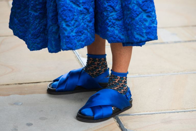 Woman wearing blue socks and sandals