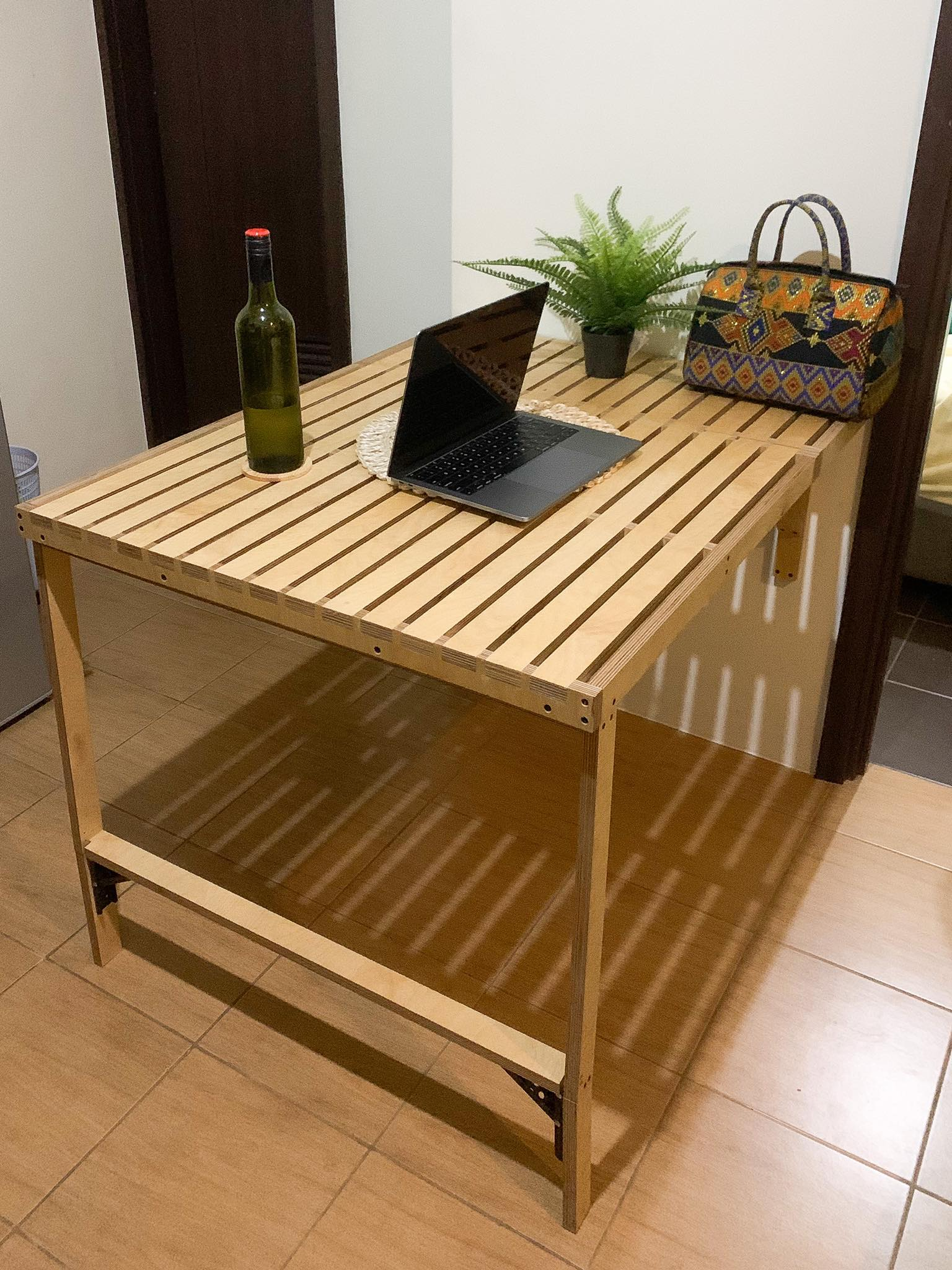 space-saving table with laptop and plants on top
