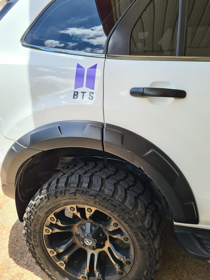 car with BTS Army decals