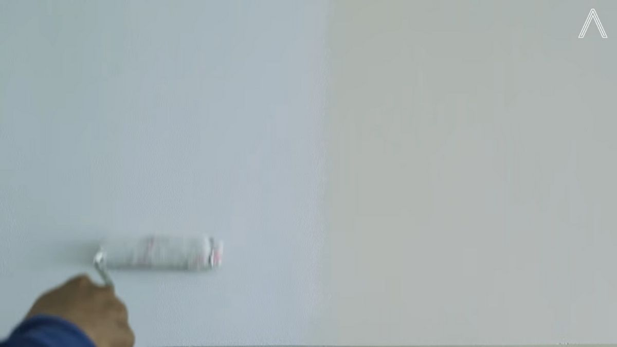 Rhian Ramos bedroom makeover: painting wall a cool grey