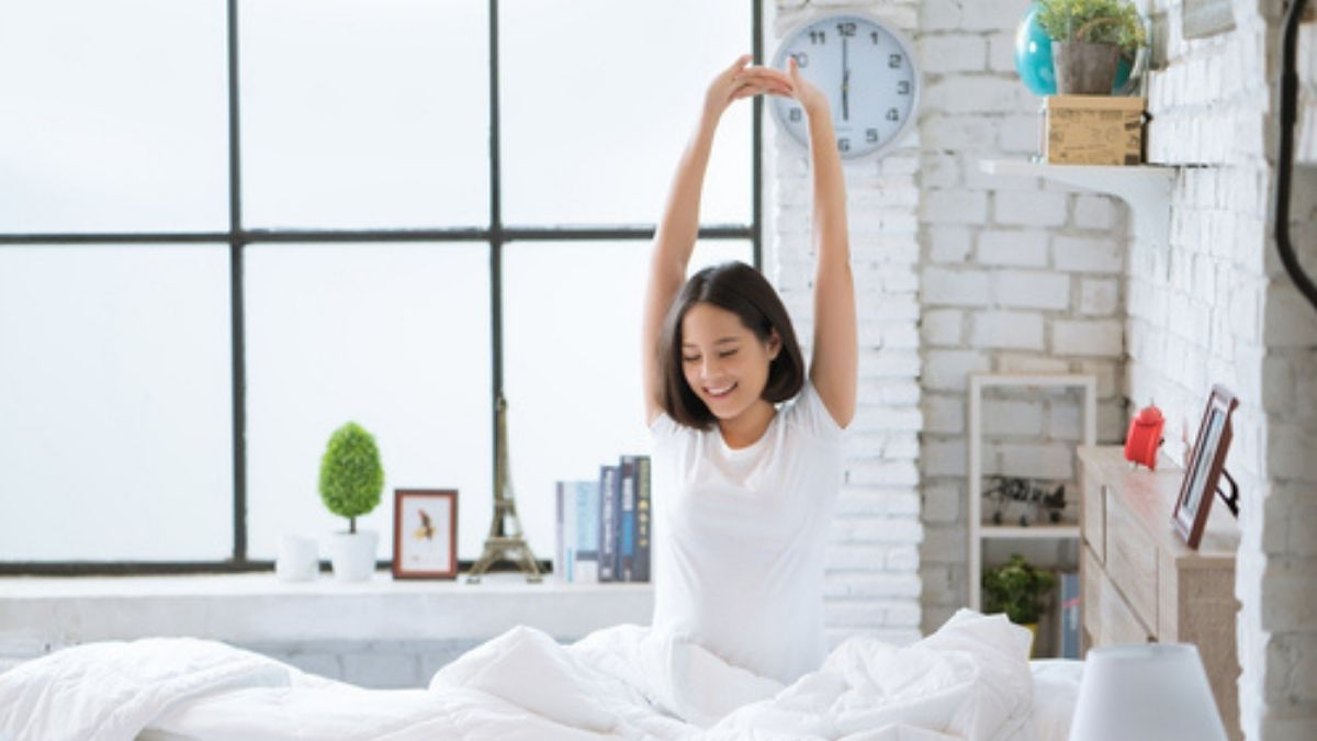 Asian woman waking up early in the morning