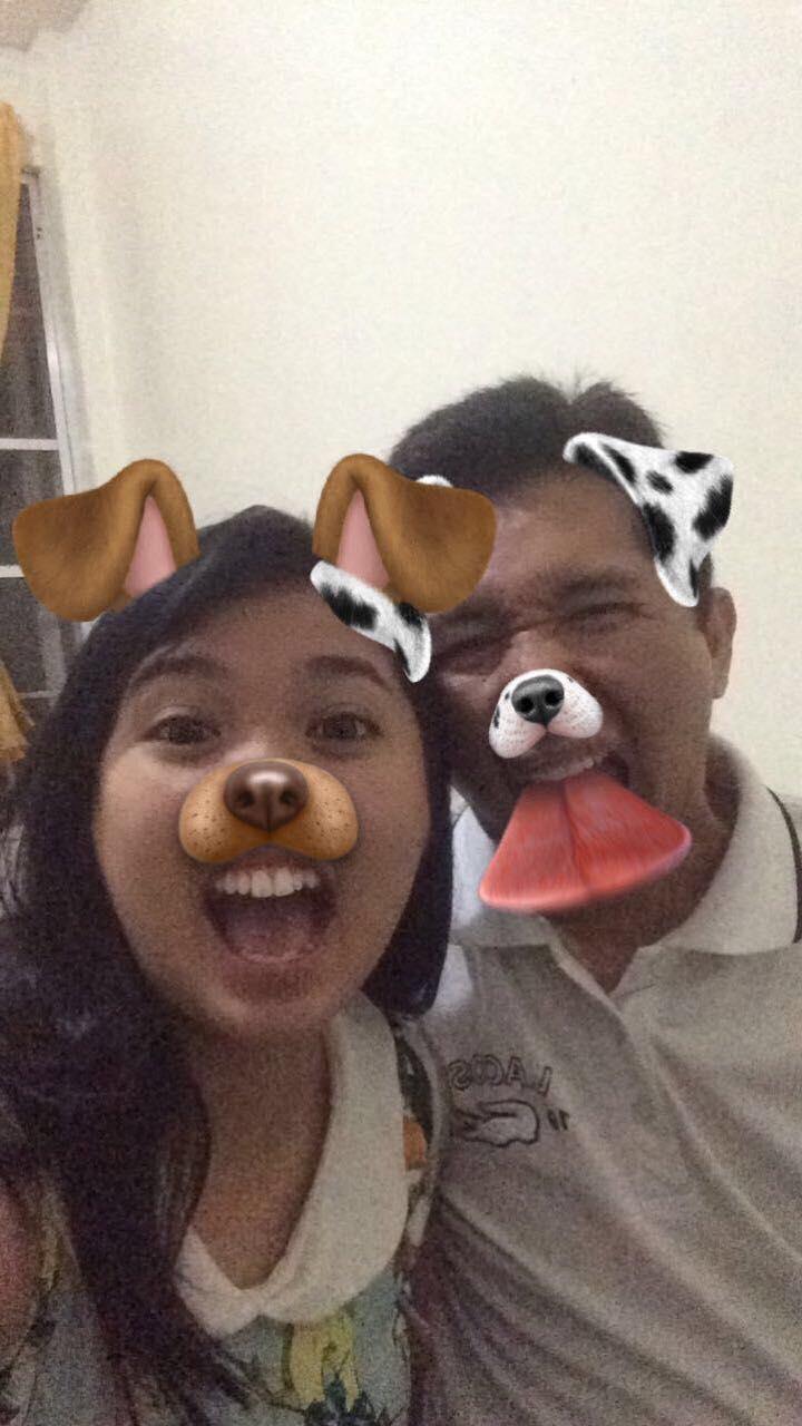 Pinay with dad, using a dog-face Snapchat filter