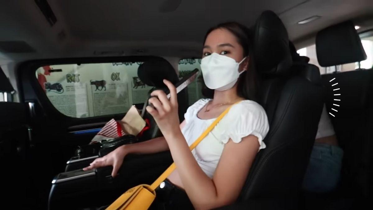 Bella Racelis buys her first car, sitting as a passenger
