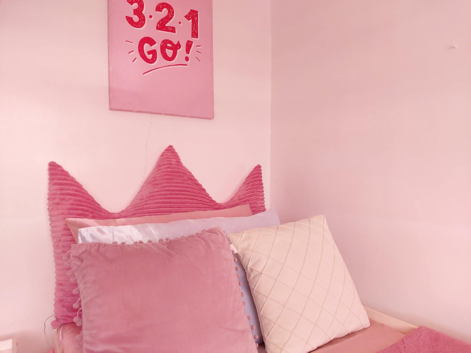 all-pink bedroom - bed, pillows, and sheets
