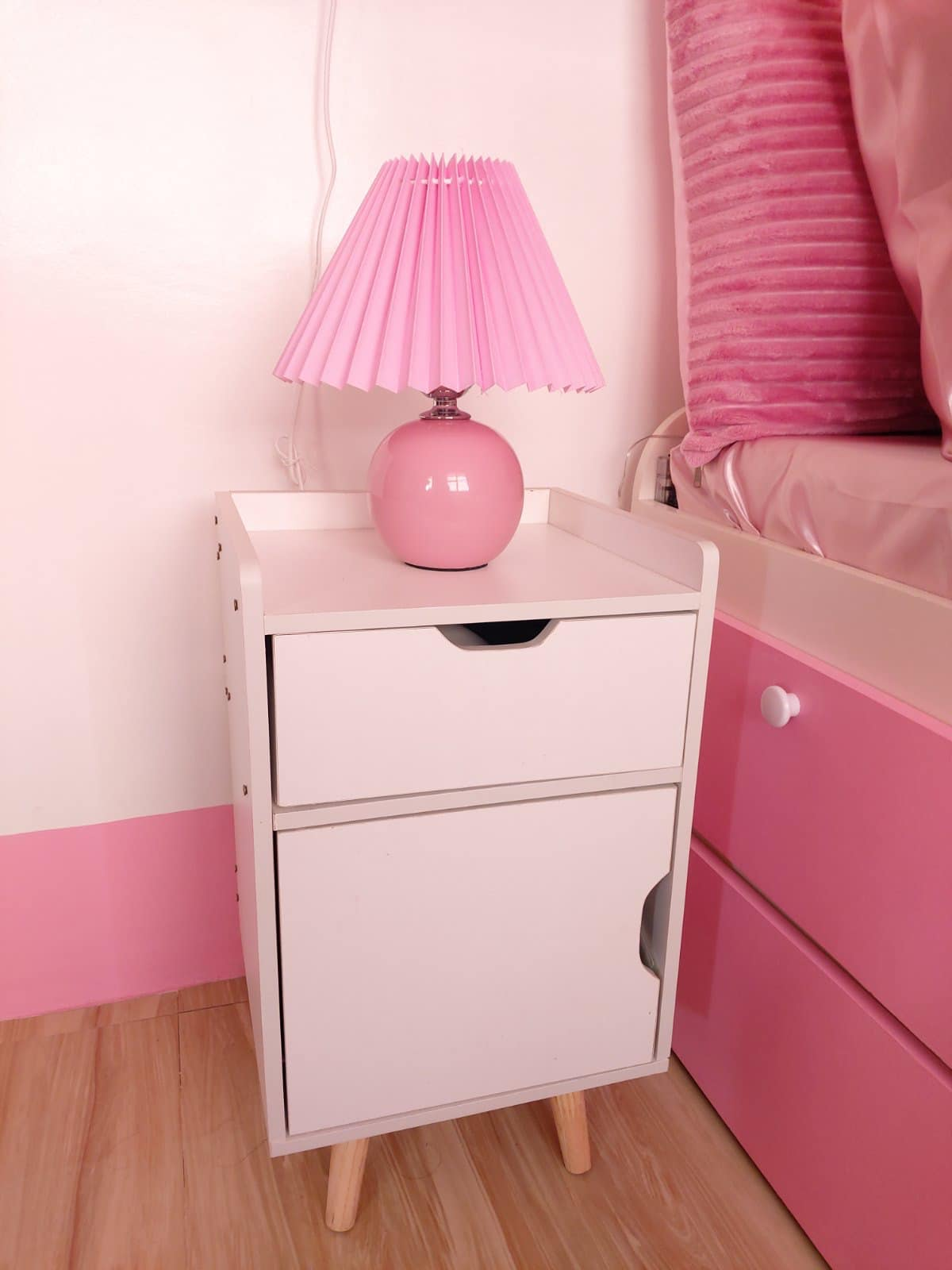 all-pink bedroom - bedside table and lamp