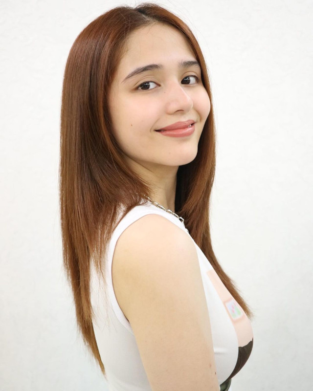 Jayda Avanzado with brown layered hairstyle