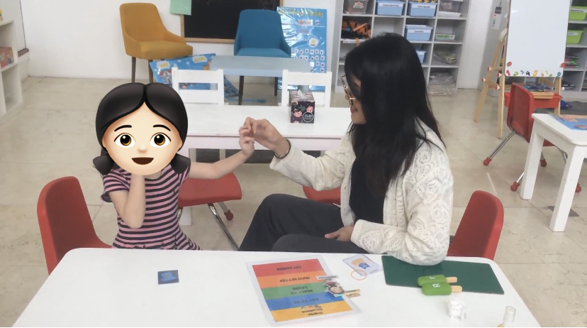 pinay behavioral therapist with student