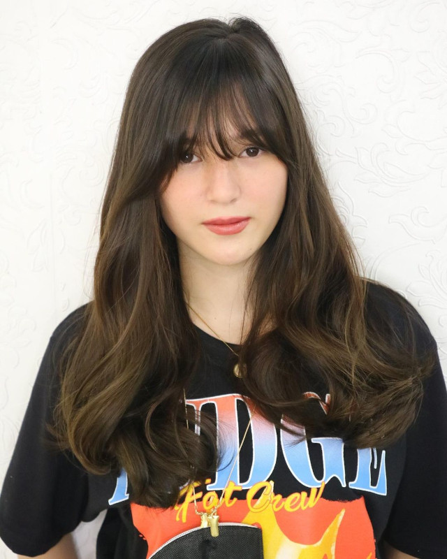 Barbie Imperial  with long hair and wispy bangs hairstyle