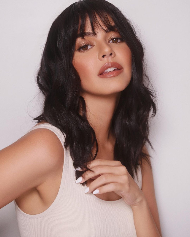 Janine Gutierrez  with long hair and wispy bangs hairstyle