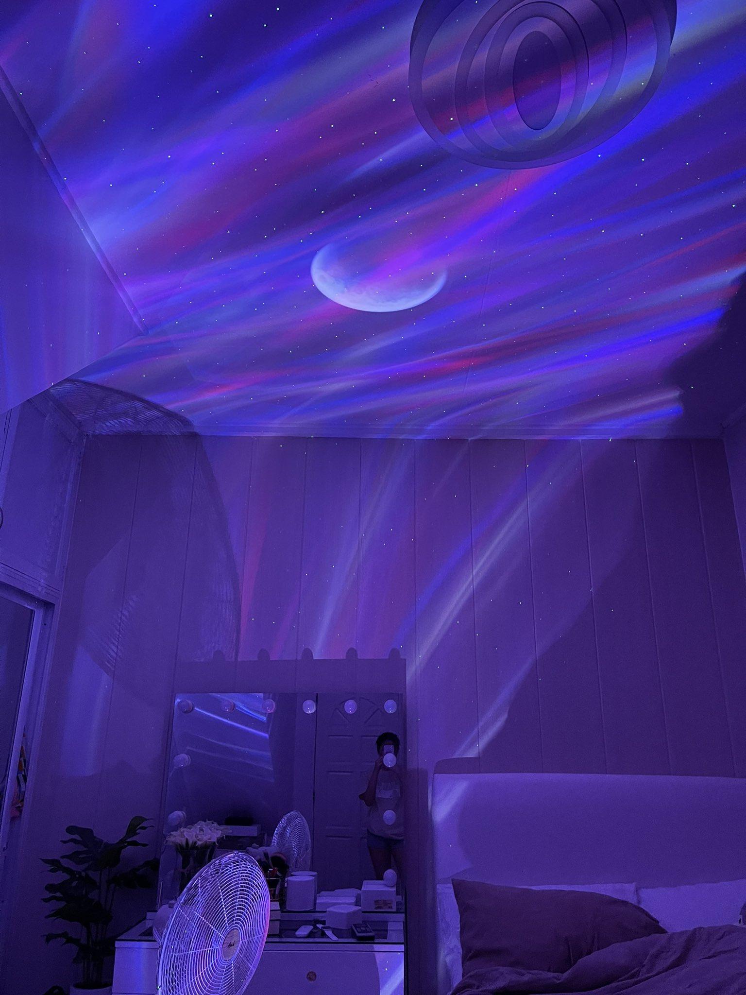 night light galaxy projector in bedroom