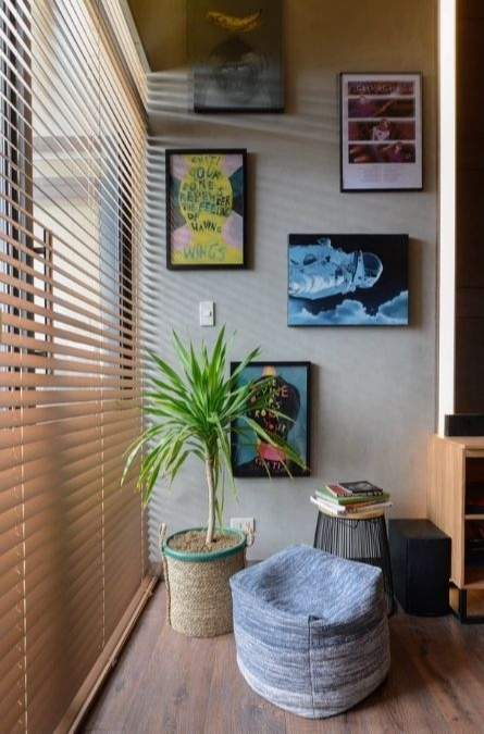 bedroom wall design ideas; frames on wall and plant