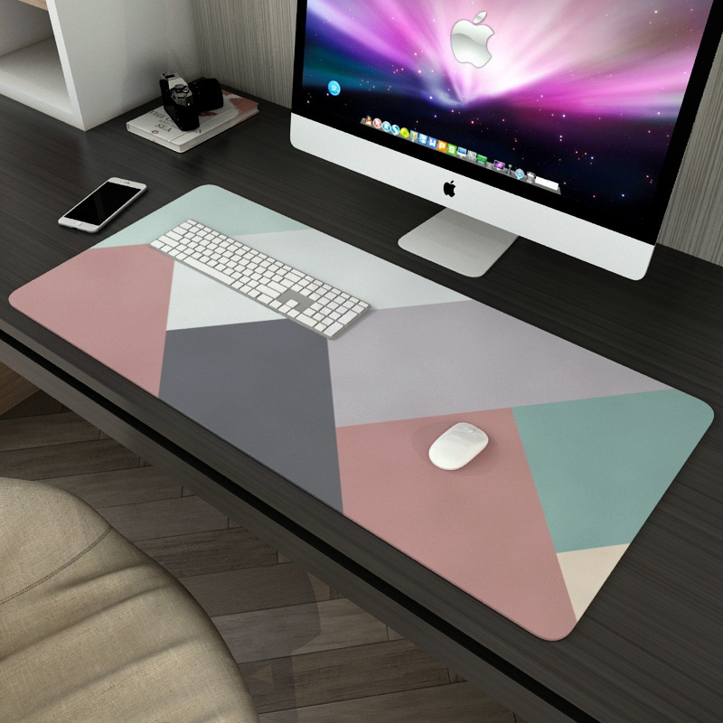 desk mat in multicolored geometric pattern
