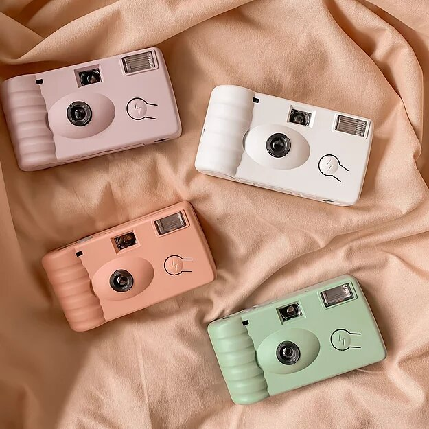 Ben and Bart disposable film cameras in Peach, Lilac, White, and Olive
