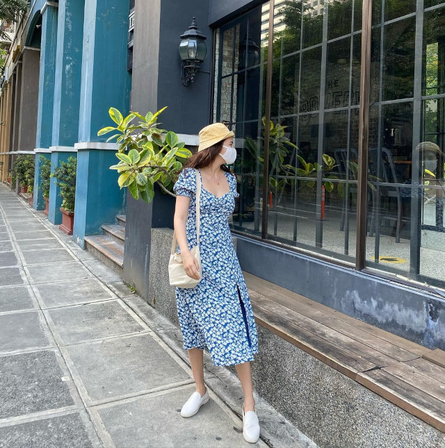 Bela Padilla wearing a blue and white floral dress.