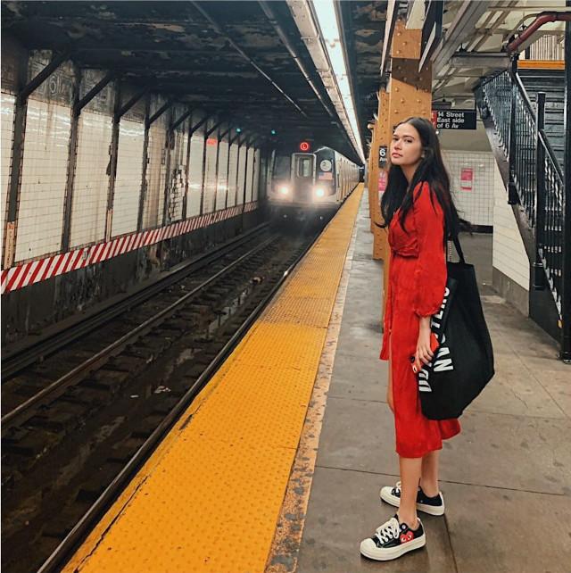Bela Padilla wearing a red dress.