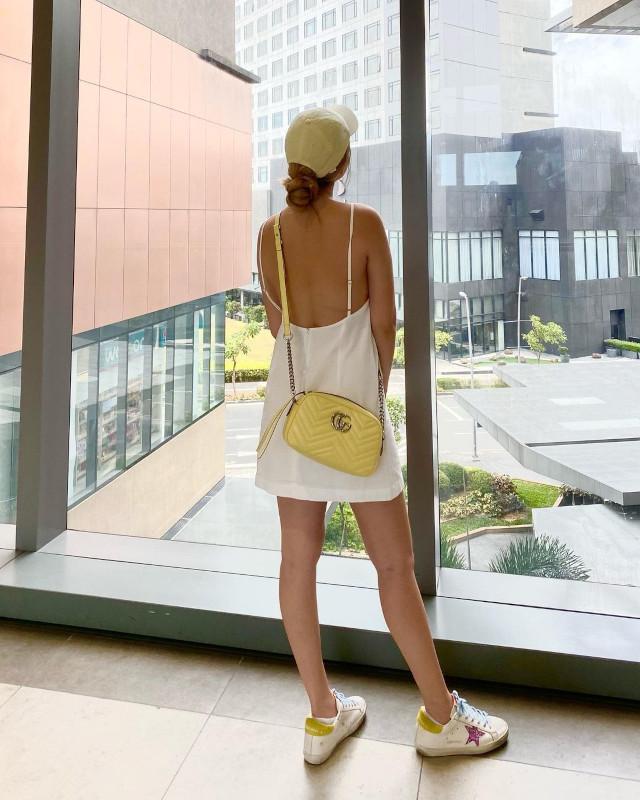 Bela Padilla wearing a white mini dress.