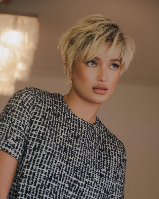 Sarah Lahbati with a blonde pixie cut