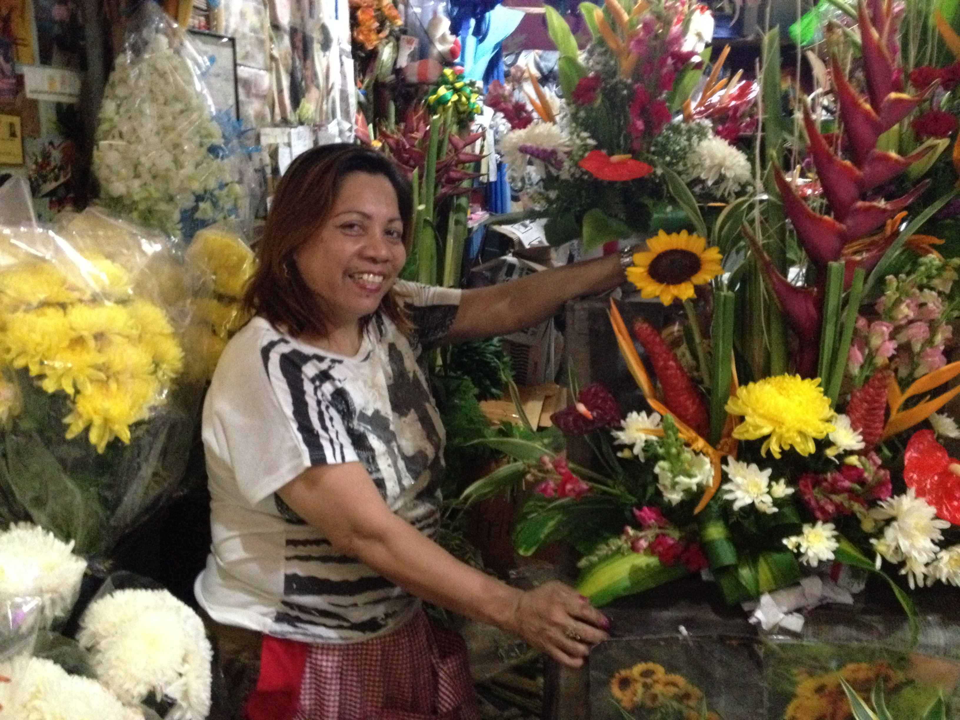 Former OFW finds success in blooming flower shop business